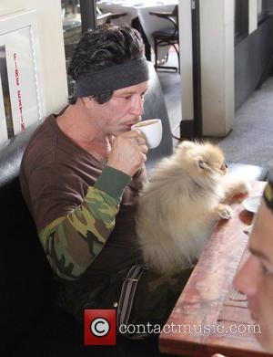 Actor Mickey Rourke goes for coffee at Cafe Roma with his dog in Beverly Hills, California, United States - Wednesday...