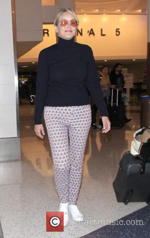 Sharon Stone arrives at Los Angeles International (LAX) Airport - Los Angeles, California, United States - Sunday 11th September 2016