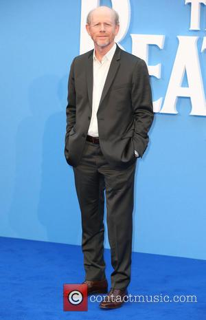 Ron Howard poses alone and with Brian Grazer at the 'The Beatles: Eight Days a Week' World Premiere held at...