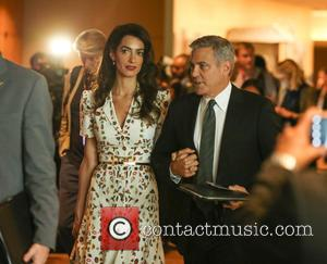 George Clooney and wife Amal Clooney at UN roundtable meeting with the president Obama at United Nations New York, United...