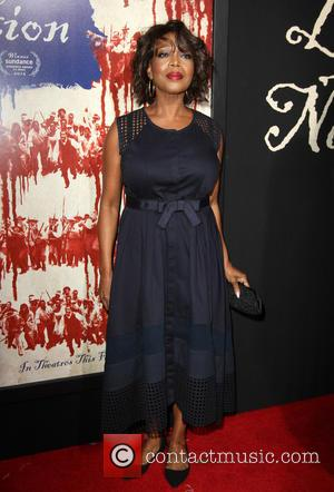 Alfre Woodard posing alone and with Roderick Spencer at the LA Premiere of 'The Birth of a Nation' held at...