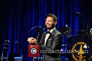 Ryan Seacrest talks to the audience at the Friars Club Gala who honoured the Icon Award to Martin Scorsese held...
