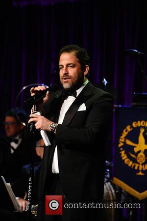 Brett Ratner talks to the audience at the Friars Club Gala who honoured the Icon Award to Martin Scorsese held...