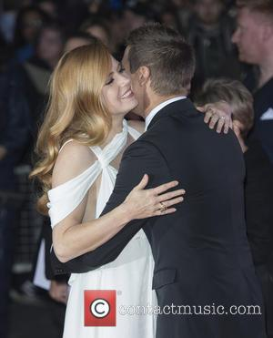 Amy Adams posing alone and with co-star Jeremy Renner at the BFI London Film Festival screening of 'Arrival' sponsored by...