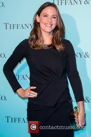 Jennifer Garner poses alone and with Reese Witherspoon and Halle Berry at Beverly Hills Tiffany And Co. store which was...