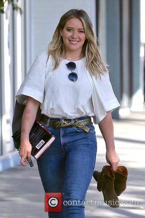 Hilary Duff seen leaving Sunset City nails carrying her boots and a book, Los Angeles, California, United States - Saturday...