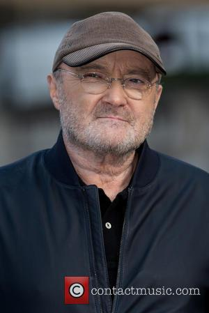 Phil Collins attends a photocall before his press conference at the Royal Albert Hall where he announced a set of...