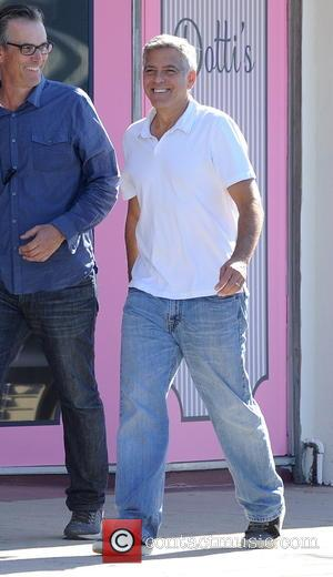 Director George Clooney seen on the set of 'Suburbicon' with actress Julianne Moore who was wearing yellow 50's attire. The...
