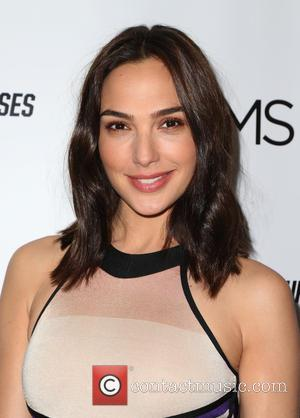 Gal Gadot poses alone and with Isla Fisher, the pair hosted a celebrity Mamarazzi screening of their new film 'Keeping...