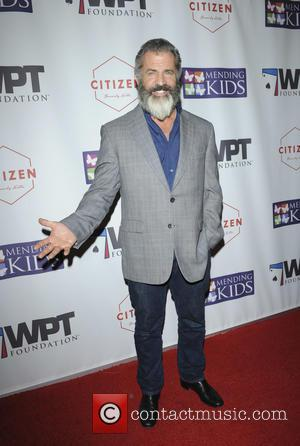 Mel Gibson seen alone and with Rosalind Ross at the World Poker Tournament Presents 'Four Kings And An Ace' held...