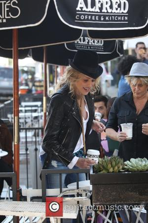 Sharon Stone takes break whilst on a movie set to have a coffee from Alfred's cafe in West Hollywood, California,...
