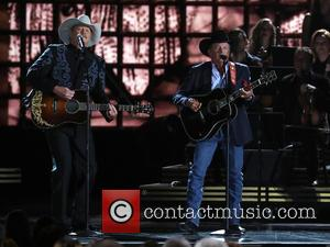 Alan Jackson and George Strait on stage at the 50th annual CMA (Country Music Association) Awards held at Music City...