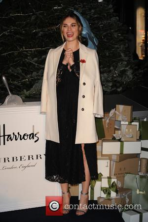 Lily James switches on the holiday lights at Harrods in collaboration with Burberry for their new line titled 'A Very...