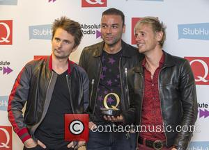 Muse seen holding their award in the press room at the 2016 StubHub Q Awards. The trio won the 'Best...
