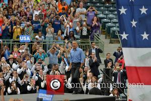 President Barack Obama stops for photos after speaking at a campaign rally for Hillary Clinton to a crowd of 11,000...