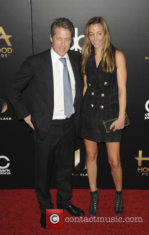 Hugh Grant and Anna Elisabet Eber