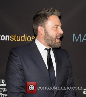 Ben Affleck seen alone and with his brother Casey Affleck at the Premiere of 'Manchester by the Sea' held at...