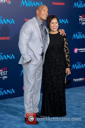 Dwayne Johnson and Lauren Hashian seen attending the premiere of Disney's 'Moana,' during AFI FEST 2016 presented by Audi, held...