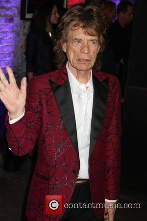 Mick Jagger seen alone and with Keith Richards, Ronnie Wood,Tommy Hilfiger and Charlie Watts at The Rolling Stones Exhibitionism opening...