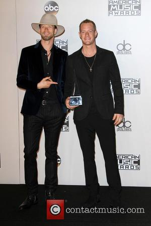 Brian Kelley and Tyler Hubbard of Florida Georgia Line in the press room at the 2016 American Music Awards -...