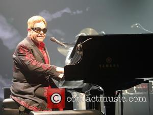 Elton John Breaks Down Onstage During Emotional George Michael Tribute