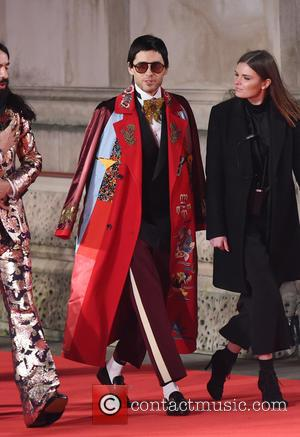 Jared Leto wearing a stunning long red coat with intricate embroidery as he attends the British Fashion Awards. - London,...