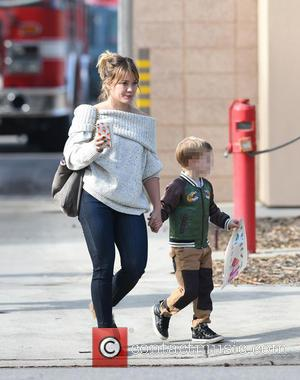 Hilary Duff has fun with her son Luca Comrie at a demonstration by the Los Angeles Fire Department Studio City...