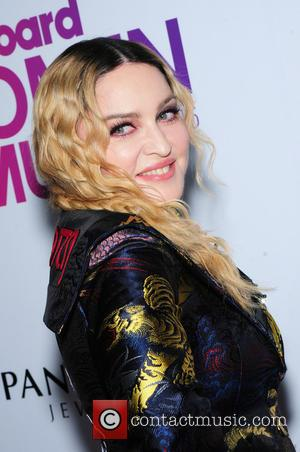 Madonna Flies Economy To Portugal And The Internet Loses Its Mind