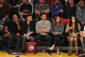 Jamie Chung seen at the Lakers game. The New York Knicks defeated the Los Angeles Lakers by the final score...