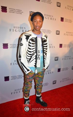 Pharrell Williams at the 'Hidden Figures' Washington, D.C. Premiere held at the Museum of African American History and Culture -...