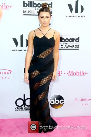 Lea Michele on the red carpet at the 2017 Billboard Music Awards held at T-Mobile Arena. Drake walked away as...