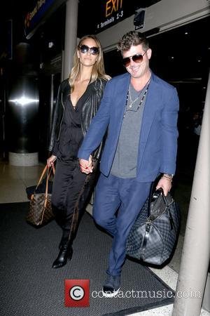 Robin Thicke and April Love Geary at Los Angeles International Airport