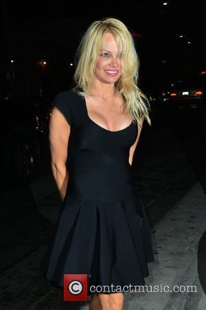 Pamela Anderson Denies Rumours Of Romance With Julian Assange