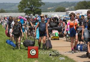 No need for wellies at this year's Glastonbury! Festival goers seen on site on the first day of the festival...