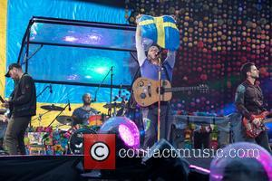 Chris Martin and the rest of Coldplay perform live onstage at the Ullevi Stadium in Gothenburg, where they played to...