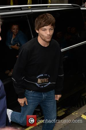 Louis Tomlinson - Louis Tomlinson arrives at The Kiss FM Studios where many fans had queued for hours - London,...