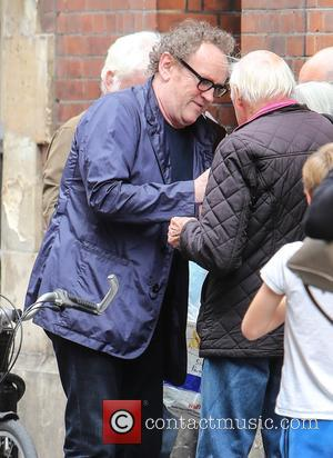 Colm Meaney signs autographs for fans at the stage door of the Apollo Theatre before a matinee performance of