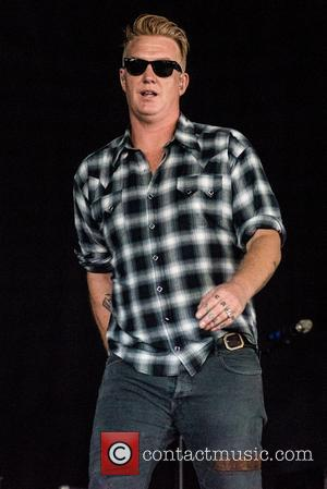 Josh Homme and the rest of Queens of the Stone Age perform a secret set at Leeds Festival 2017 -...