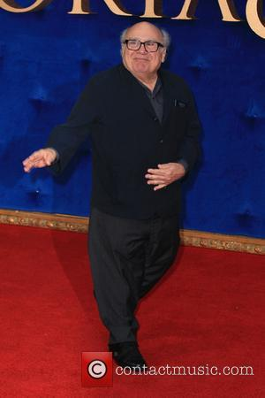 Danny DeVito Takes Cardboard Fan To Work After She Took 'Him' To Prom