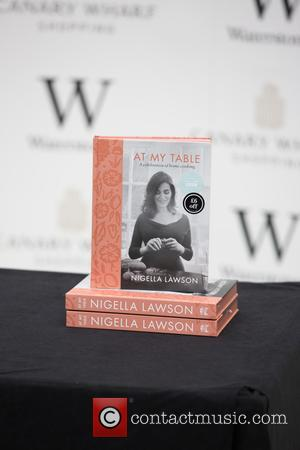 Popular TV chef Nigella Lawson signs copies of her latest cookery book, 'At My Table: A Celebration of Home Cooking'...