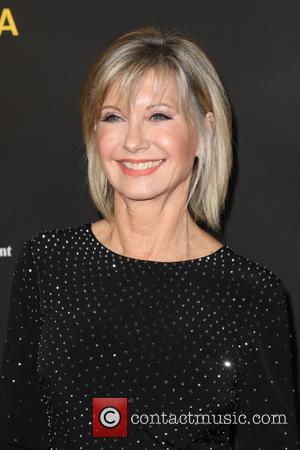 Olivia Newton-John Using Positivity To Beat Cancer For The Third Time
