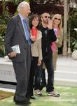 George Martin, Olivia Harrison and Ringo Starr