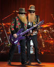 Zz Top Scrap Weekend Shows As Bassist Recovers From Dislocated Shoulder