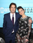 Luke Wilson and Carla Gugino