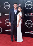 Aaron Ridgers and Olivia Munn